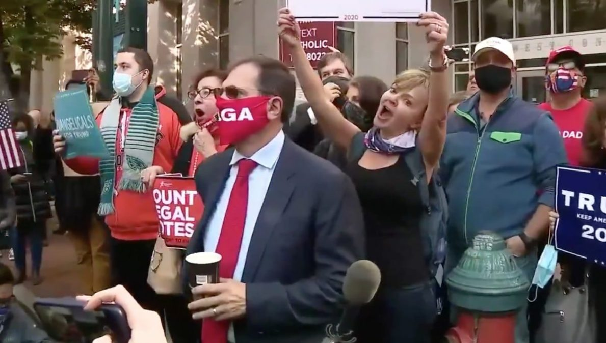 Trump maga fans sing and hold signs
