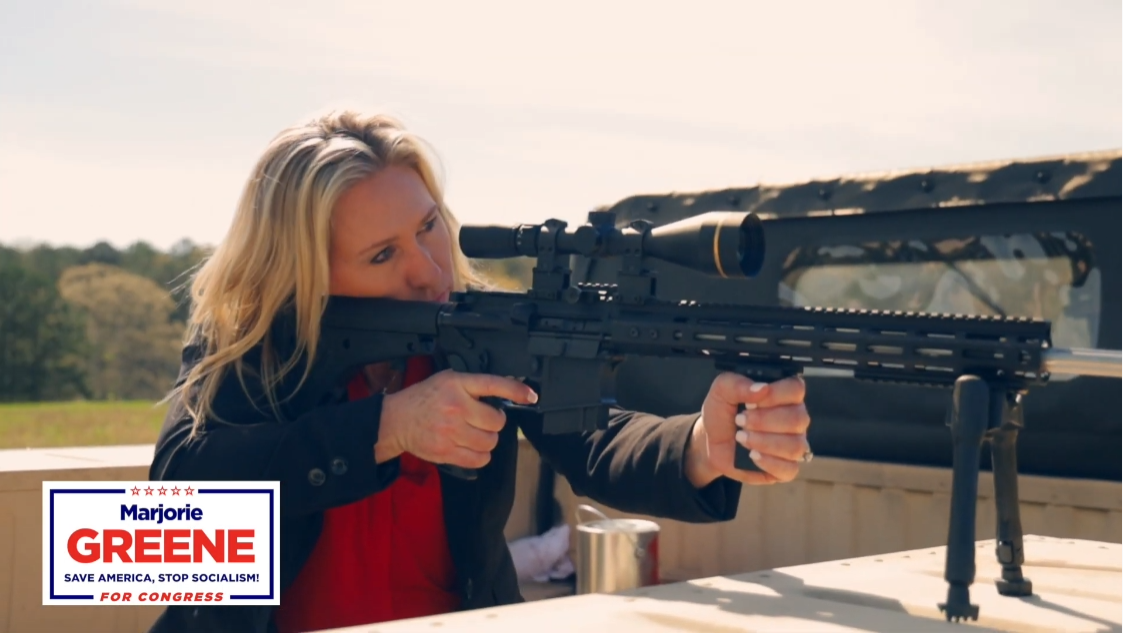 Congresswoman-elect Marjorie Taylor Greene aims a rifle.