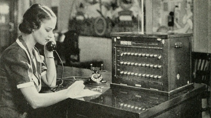 "Image from page 287 of ""Bell telephone magazine"" (1922) of a woman operating a local switchboard"