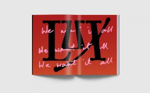 """The Lux Magazine logo with the phrase """"we want it all,"""