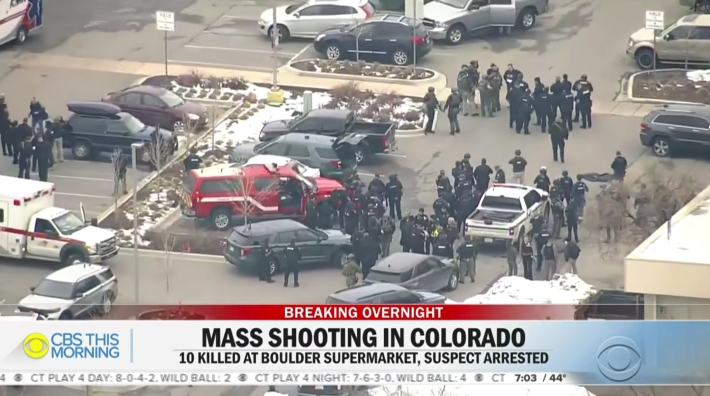 Picture showing law enforcement responding to the mass shooting in Boulder, CO