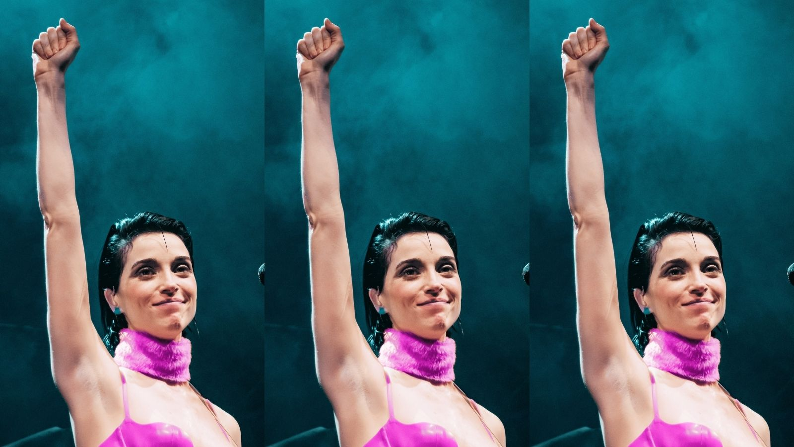 St. Vincent raising her fist in the air