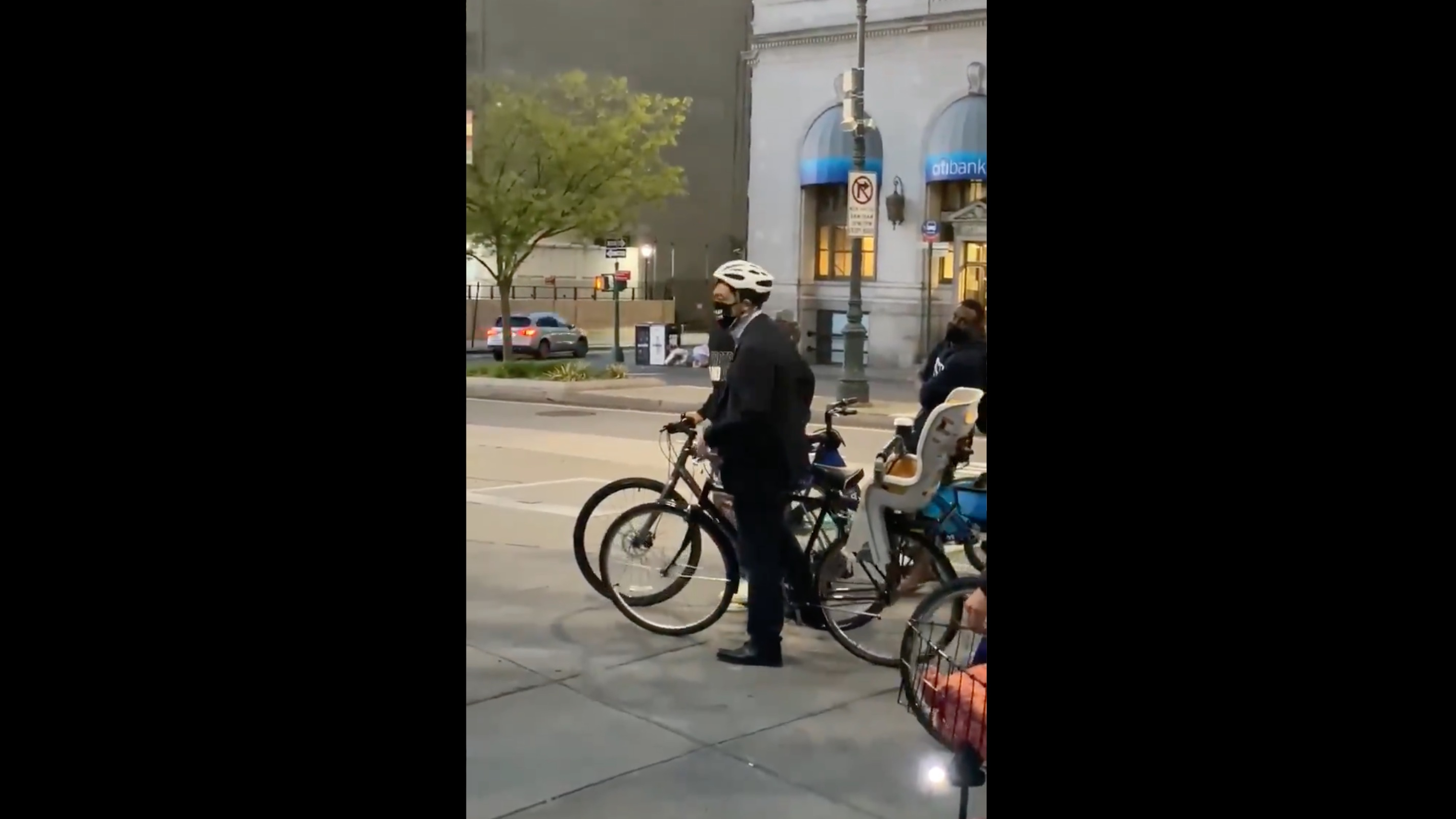 Andrew Yang on his bike being heckled out of a Daunte Wright protest by people pointing out that he is pro-cop