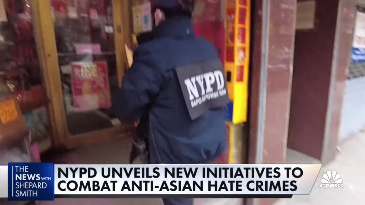 Footage of an NYPD officer entering an Asian business as part of an initiative to increase patrols of Asian neighborhoods.