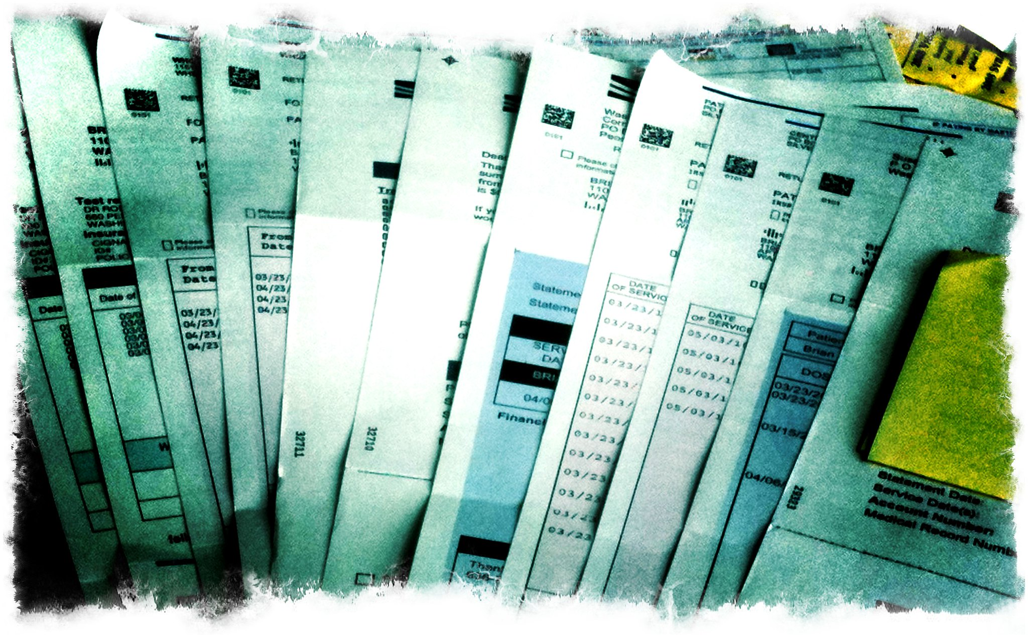 Photo of medical bills received by Americans in debt