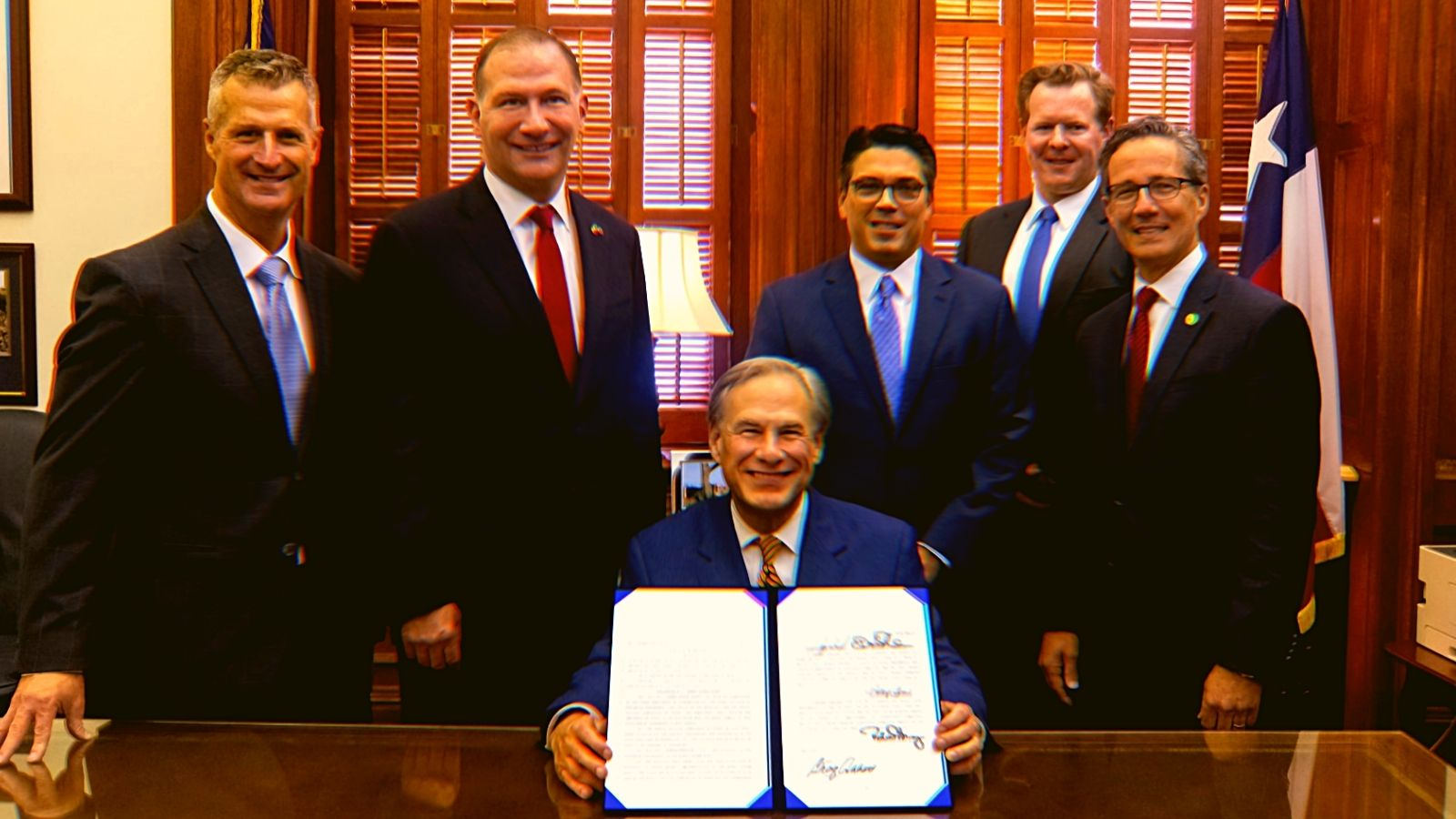 """Texas Gov. Greg Abbott and other legislators """"signing laws to reform ERCOT and weatherize and improve the reliability of Texas' power grid."""""""
