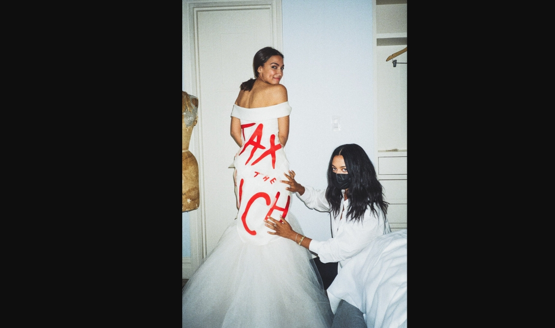 AOC shows off her 'tax the rich' dress.