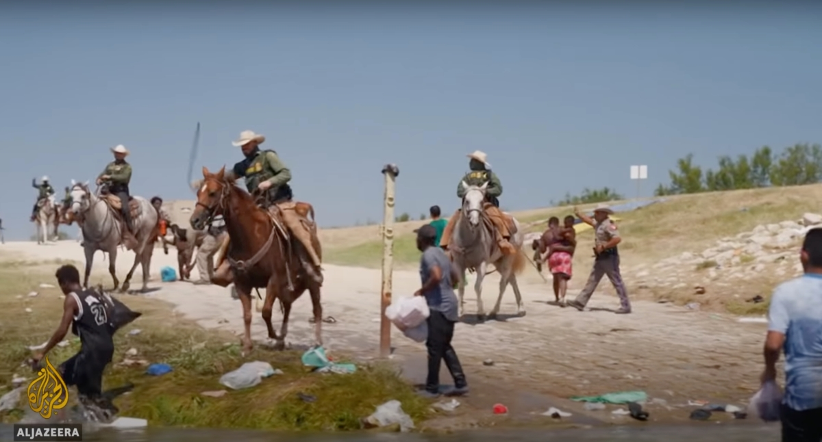 Haitian migrants being rounded up by US government agents on horseback in Texas.