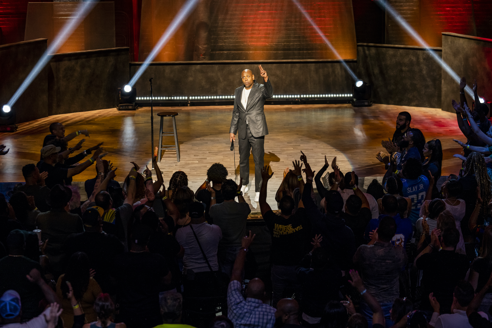 Dave Chappelle standing on stage for his latest Netflix special, 'The Closer.'